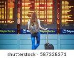 beautiful young tourist girl... | Shutterstock . vector #587328371