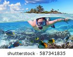 young woman at snorkeling in... | Shutterstock . vector #587341835