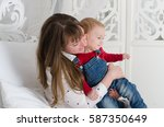happy mother playing and hug... | Shutterstock . vector #587350649