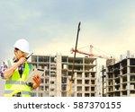 engineers building blocks and... | Shutterstock . vector #587370155
