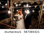 the bride keeps an alpple and... | Shutterstock . vector #587384321