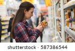 woman buys honey in supermarket ... | Shutterstock . vector #587386544