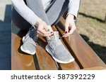 tying sports shoes | Shutterstock . vector #587392229