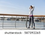 young woman stretching after... | Shutterstock . vector #587392265