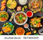 asian food served on black... | Shutterstock . vector #587404205