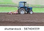 Tractor With Cultivator Harrow...
