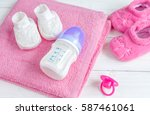 baby bottle with milk and towel ... | Shutterstock . vector #587461061