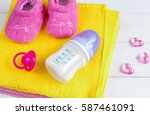 baby bottle with milk and towel ... | Shutterstock . vector #587461091