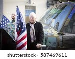 Small photo of NEW YORK - NOV 11, 2016: Steve Maloney and his mixed-media sculpture Take Me Home Huey, a restored US Army Huey air ambulance helicopter from the Vietnam War in the Americas Parade on Veterans Day.