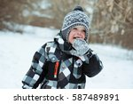 Little Funny Boy Eating Snow....