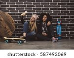 lifestyle portrait of two...   Shutterstock . vector #587492069