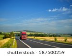 red truck arriving on the... | Shutterstock . vector #587500259