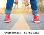 feet red sneaker a girl in...   Shutterstock . vector #587516369