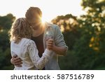 young couple dancing together... | Shutterstock . vector #587516789