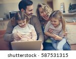 happy family spending time at... | Shutterstock . vector #587531315