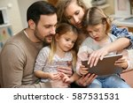 happy family spending time at... | Shutterstock . vector #587531531