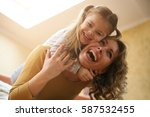 mother and daughter spending... | Shutterstock . vector #587532455
