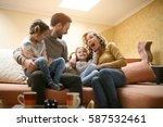 cheerful family at home... | Shutterstock . vector #587532461