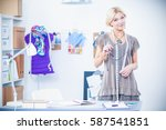 young fashion designer working... | Shutterstock . vector #587541851