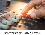 hand adjusting volume fader of... | Shutterstock . vector #587542961
