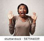 happy surprised black woman | Shutterstock . vector #587546039
