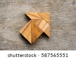 tangram puzzle in arrow shape... | Shutterstock . vector #587565551