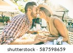 couple in love kissing at bar... | Shutterstock . vector #587598659