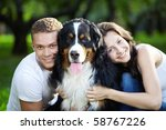 Stock photo the happy couple with a dog in the park 58767226
