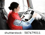 young female driver sitting in... | Shutterstock . vector #587679011
