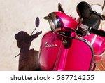 pink vespa motorbike in the sun ... | Shutterstock . vector #587714255