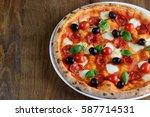 top view of neapolitan pizza...   Shutterstock . vector #587714531