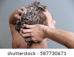 young man washing hair on color ... | Shutterstock . vector #587730671