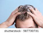 young man washing hair on color ... | Shutterstock . vector #587730731