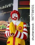 """Small photo of Bangkok, Thailand- Feb 2017: Ronald McDonald charactor in front of McDonald restirant. In Thailand, this posture mean pay respect to and always use when we meet and say """"Hello"""""""