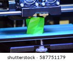 3d printer works and creates an ... | Shutterstock . vector #587751179