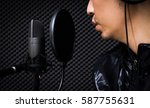 asian singer singing with... | Shutterstock . vector #587755631