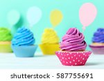 tasty cupcakes on a green... | Shutterstock . vector #587755691
