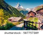 sunny summer morning in zermatt ... | Shutterstock . vector #587757389