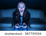 teenage girl playing a video...   Shutterstock . vector #587759534