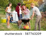 man gives grilled skewers to... | Shutterstock . vector #587763209