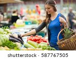 smiling woman with vegetable at ... | Shutterstock . vector #587767505