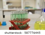 glass chemical tubes with green ... | Shutterstock . vector #587776445