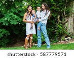 portrait of a family of four... | Shutterstock . vector #587779571