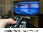watching tv and using remote...   Shutterstock . vector #587791349