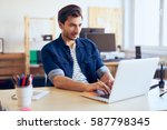 men working on laptop at... | Shutterstock . vector #587798345