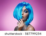 beautiful girl in blue wig | Shutterstock . vector #587799254
