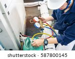 technician is checking air... | Shutterstock . vector #587800145