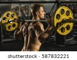 gym session. rearview shot of a ... | Shutterstock . vector #587832221
