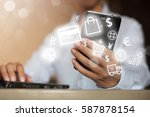 man using laptop while looking... | Shutterstock . vector #587878154