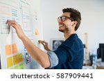 happy designer doing usability... | Shutterstock . vector #587909441